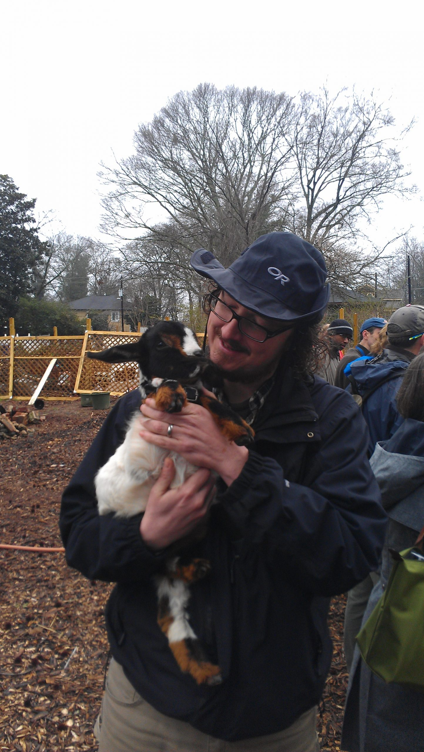 Doug Williams at the East Lake Farm with one its goat residents